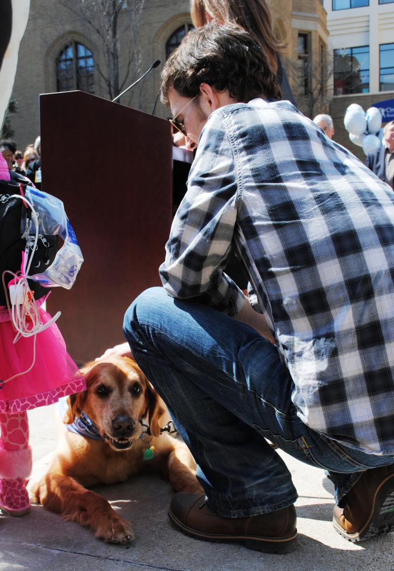 Former patient Nate Kramer with his dog, Bailey. Kramer gave input on the Family Pet Center.