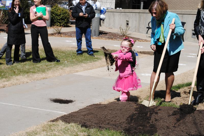 This little patient enthusiastly helped break ground on the new facility.