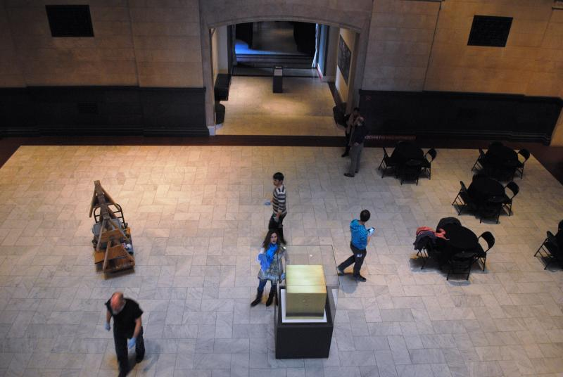The brass cube sits in the Great Hall at the end of the Schmidlapp Gallery.