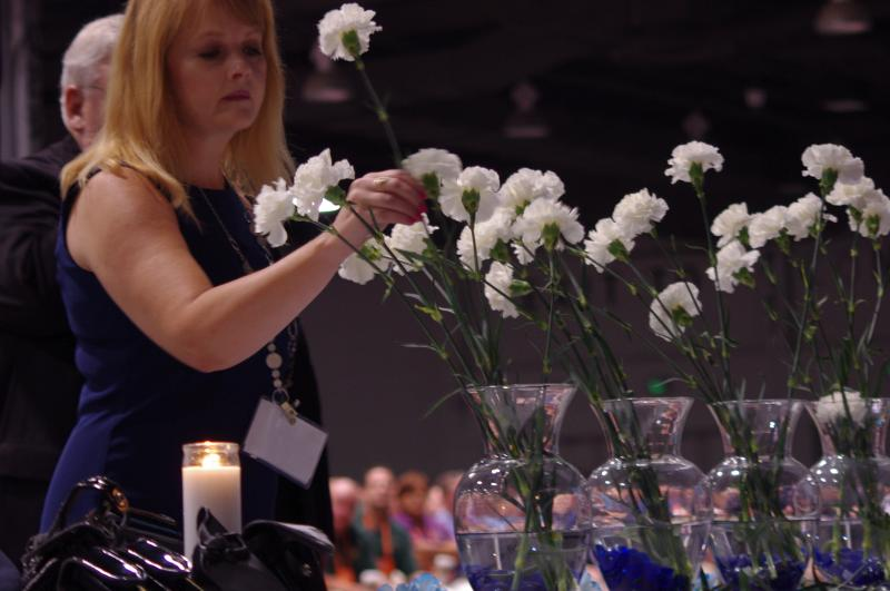 White carnations, one from each state, are placed in vases to remember fallen officers.