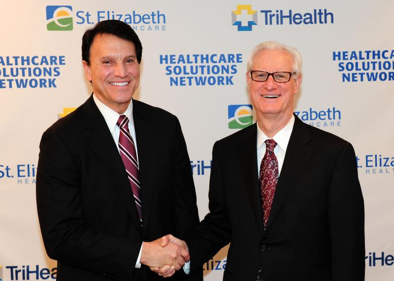 John Dubis, St. Elizabeth Healthcare CEO, and John Prout, TriHealth CEO.