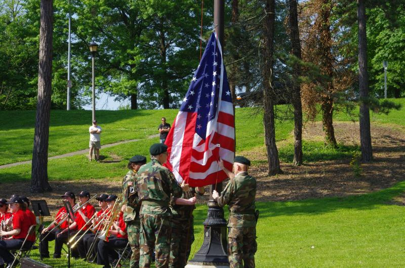 A color guard raises posts the American flag during a Memorial Day ceremony in Eden Park