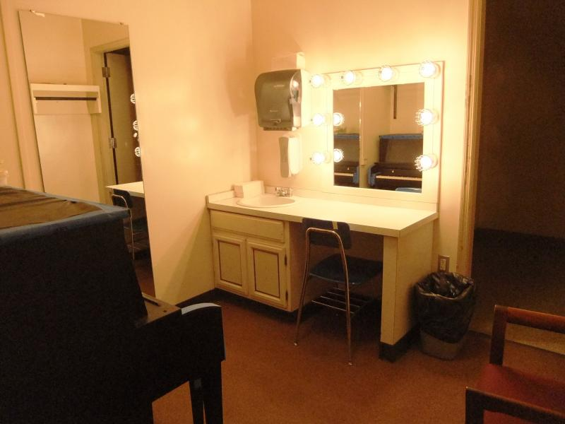 Small dressing rooms feature outdated amenities and must hold several performers each.