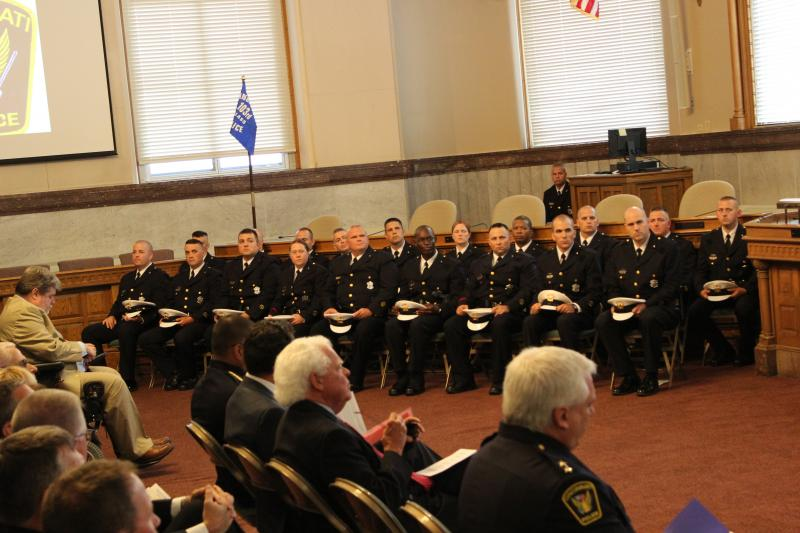 The 19 new officers were sworn in before friends, family and former co-workers from their old departments.