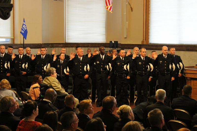 The recruits are sworn in during their graduation ceremony July 3, 2014.