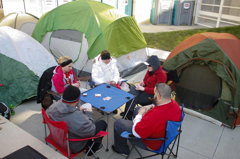 Dustin Horn and Dan Calton from Middletown meet Shyla Miller, Kristen Brafford and Amy Thompson to play a game of cards while waiting in line for Opening Day Reds tickets.