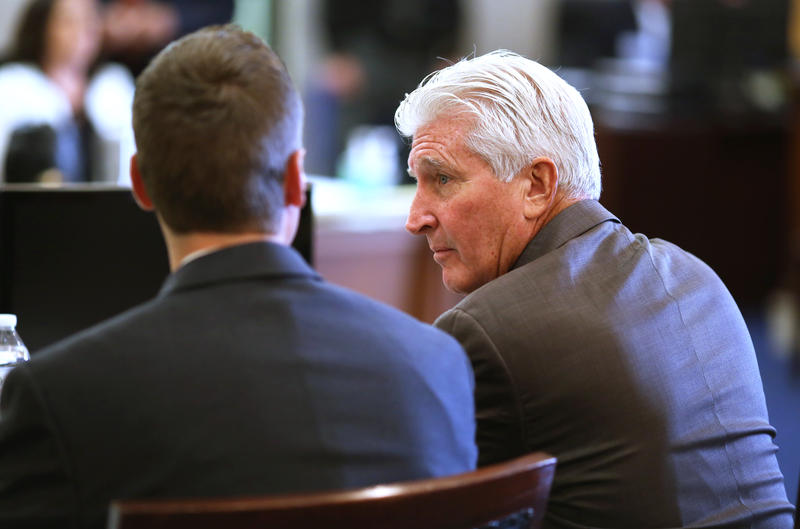 Ray Tensing's lawyer, Stew Mathews, speaks to his client during jury selection in the courtroom of Common Pleas Judge Megan Shanahan in the Hamilton County Courthouse.