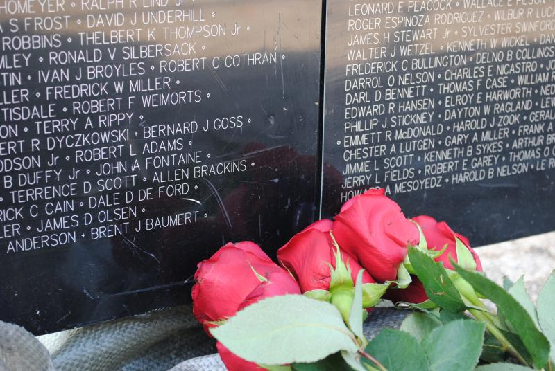 Much like the wall in Washington DC, several people left roses for loved ones lost in the war.