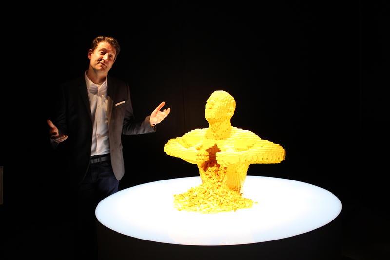 "Artist Nathan Sawaya in Cincinnati with his work ""Yellow."""