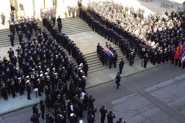 The body of FAO Daryl Gordon is carried into St. Peter in Chains Cathedral.