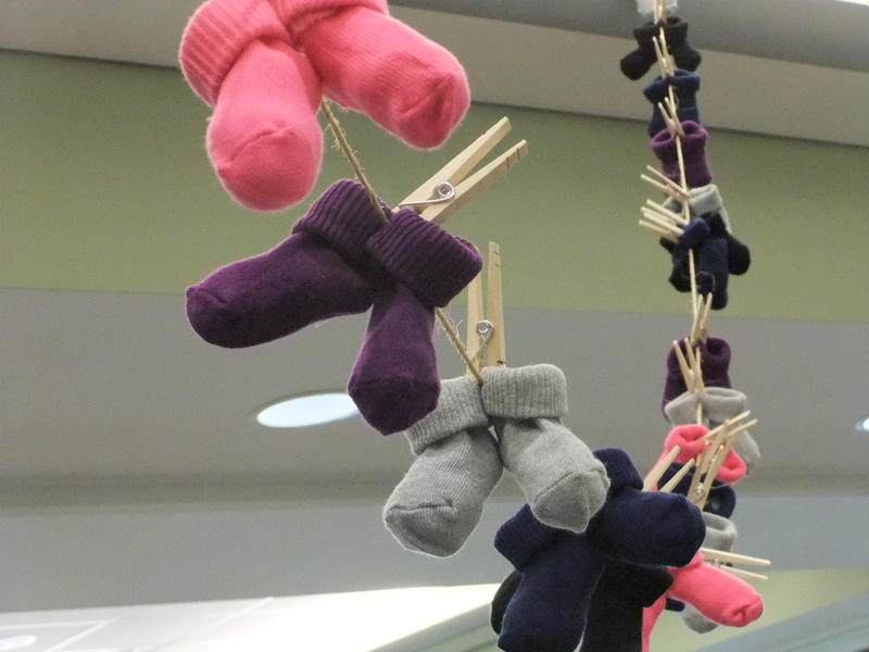 95 pairs of baby socks/booties represent the 95 babies that died in Hamilton County in 2013 before turning one year old.