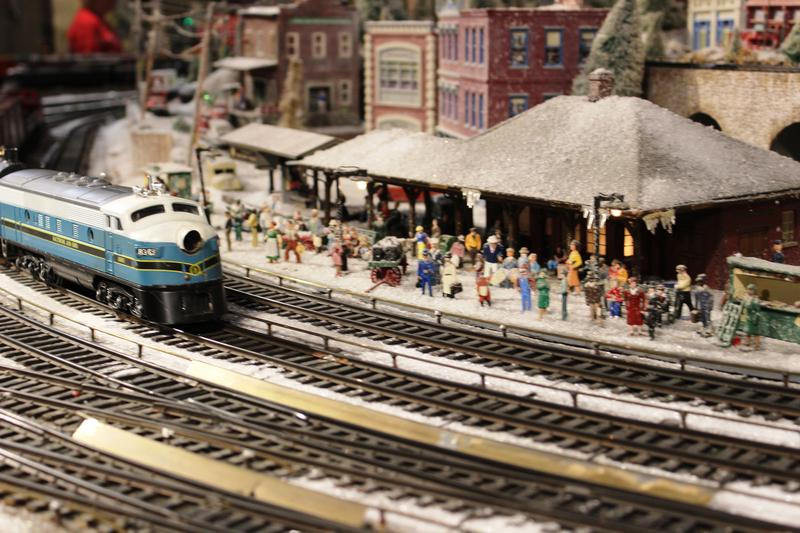 "According to the Museum Center, ""The trains are authentic ""O"" gauge in which a quarter inch on the model is dquivealent to one foot on a real train; rail cars, tracks, and buildings are 1/48th actual size."""