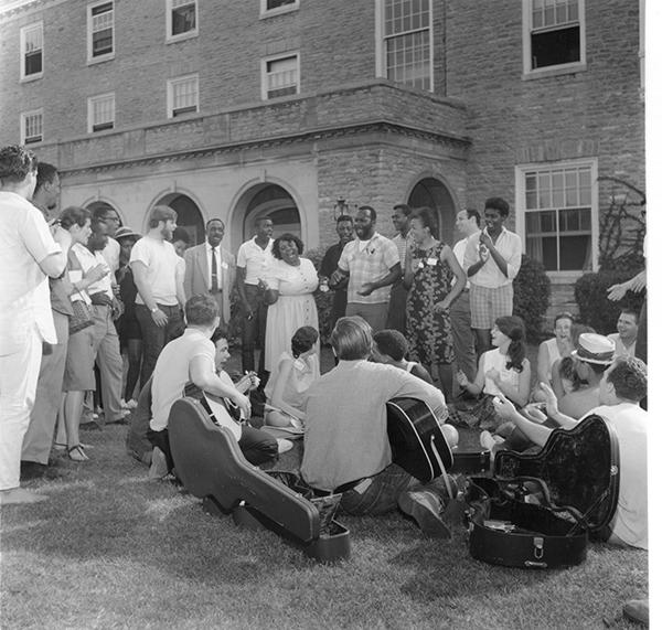 Freedom Summer workers and volunteers gather to sing outside of Clawson Hall.