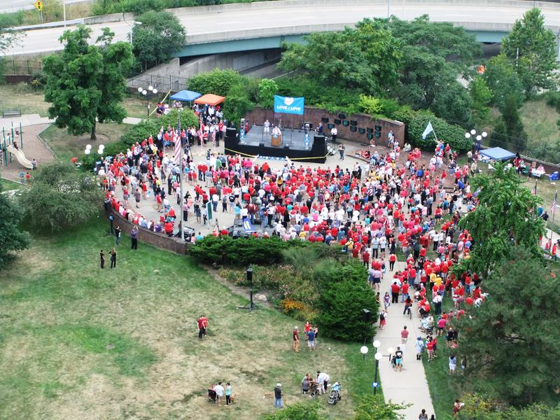 Several hundred people rally Tuesday ahead of the appeals court hearing.