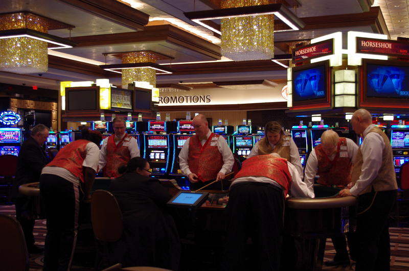 Dealers practice at a Craps table.