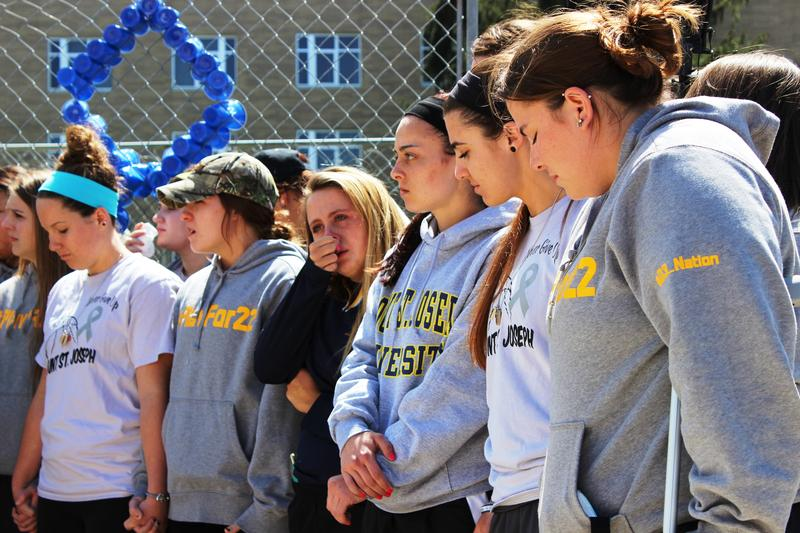 Hill's basketball teammates held hands and remembered her during a Friday vigil.