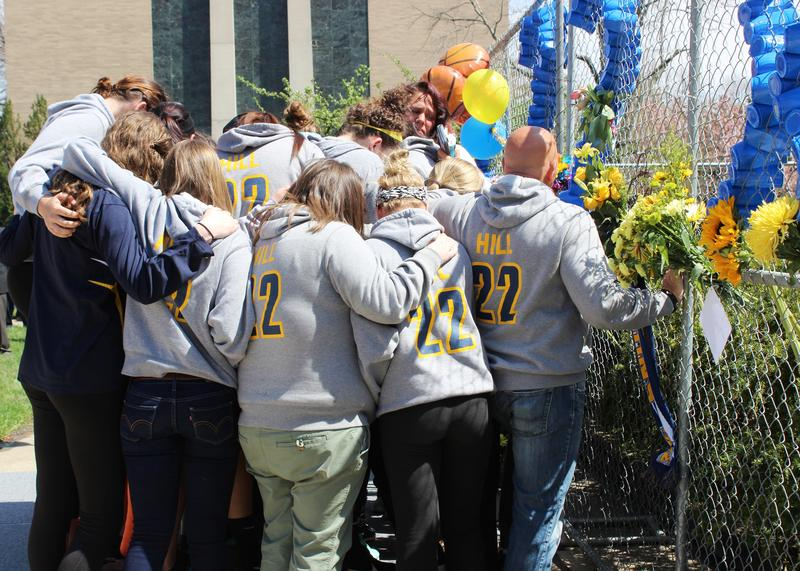 Teammates huddle in prayer and consolation following the vigil for Lauren Hill.