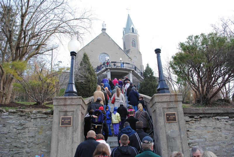 "People reverently ""praying the steps"" at Holy Cross-Immaculata Church in Mt. Adams."