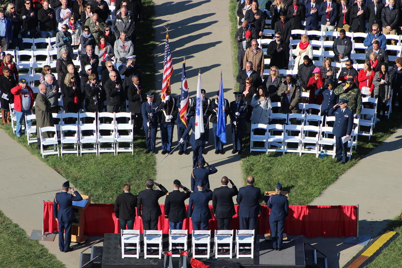 The UC ROTC Color Guard presents the colors.