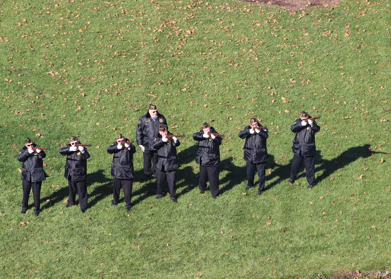 Members of the Salute Squad issue a 21 gun salute.