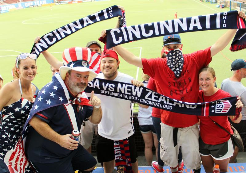 Fans in the American Outlaws fan section show their excitement before the game.