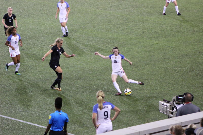 Midfielder Rose Lavelle plays the ball forward Tuesday night at Nippert Stadium in Cincinnati.