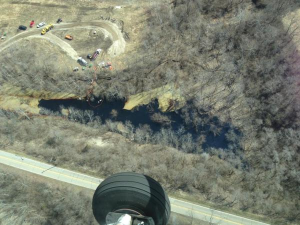 Aerial view of oil spill on the pond. East Miami River road is at the bottom of the pic (which is on the west side of the pond.)