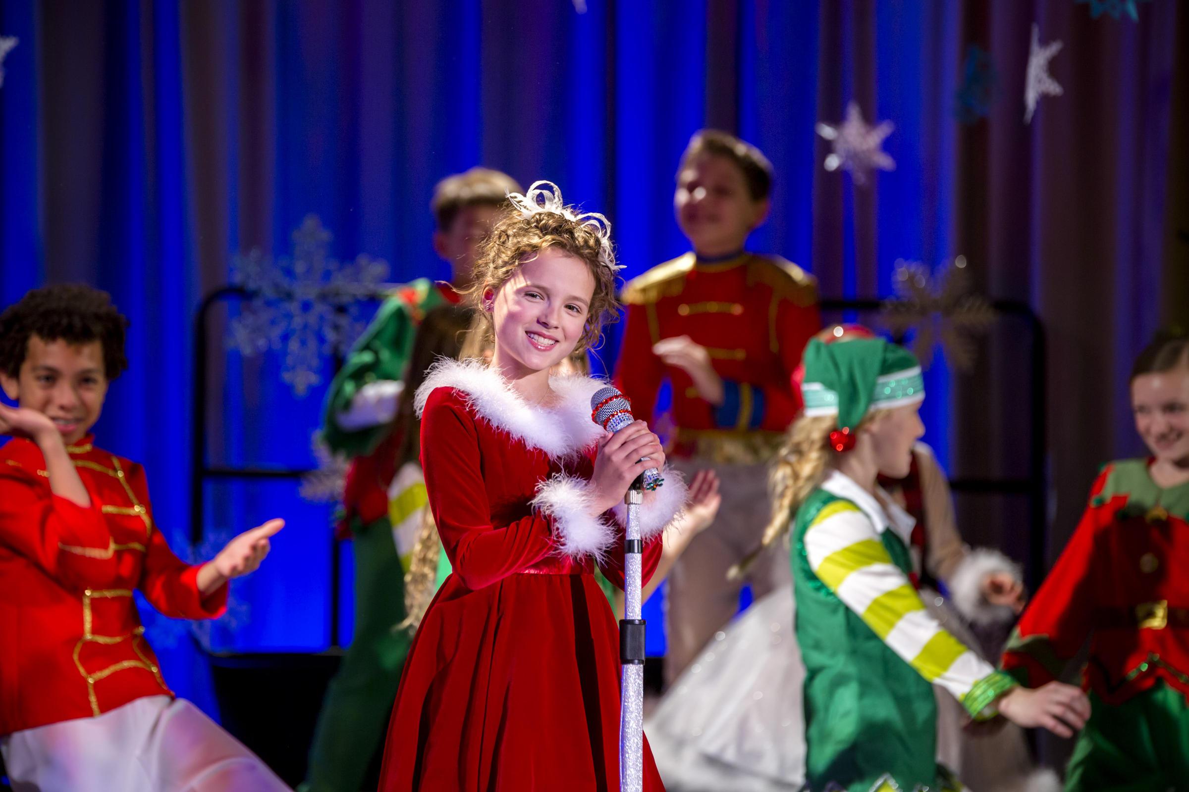 broadway star fina strazza singing oh santa on the kilgour elementary school stage in october - Hallmark Christmas 2015