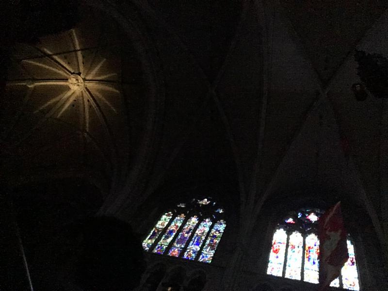 A star is projected on the vaulted ceiling of the Princeton University Chapel
