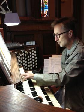 Albinas Prizgintas at the grand organ in Trinity Church.