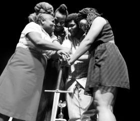 Members of Team Slam New Orleans (SNO) winning the National Poetry Slam in 2012.