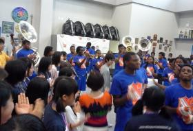 Students at the new Walker and Landry high school second-line during band rehearsal.