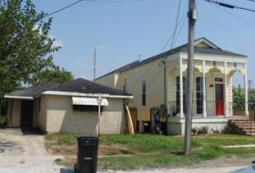 The more modern house on the left remains a blight on the neighborhood. Becnel hopes the city will demolish it.