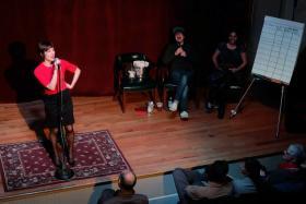 WWNO News Director Eve Troeh, hosting a recent installment of The Moth.