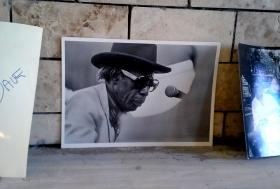 A photo of Professor Longhair sits on the mantle he loved.