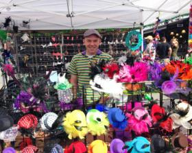 Jason Tullos sells colorful and popular diminutive headgear.