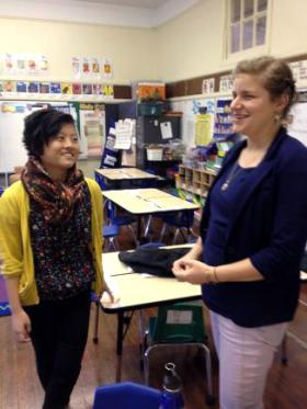 Nobile and Shafer chat in Nobile's first grade classroom.