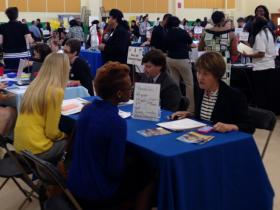 Prospective teachers sit down for interviews at the 8th Annual Charter School Teacher Fair.