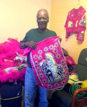 Big Chief Monk Boudreaux shows off this year's suit at his home in New Orleans' Uptown neighborhood.
