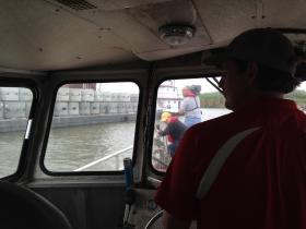 Ben Leblanc navigates his boat to the oyster restoration site