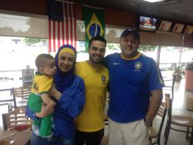 Sami, Falastin and Bashar Ahmad celebrate a World Cup victory with owner Eddie Martins.