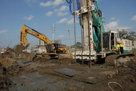 Workers pump cement slurry into the foundation of the 17th Street Canal in March 2011.