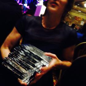 WWNO News Director Eve Troeh at the Excellence in Journalism ceremony, with an armful of awards.