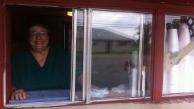 Bertha Pellegrin sells sno-balls to customers in Chauvin from the window of her store, Mae Mae's.