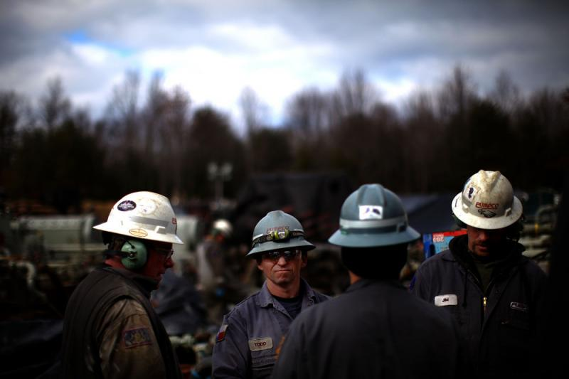 Workers at Chesapeake Energy, one of the biggest gas companies conducting fracking, are seen on the job site near Towanda, PA.