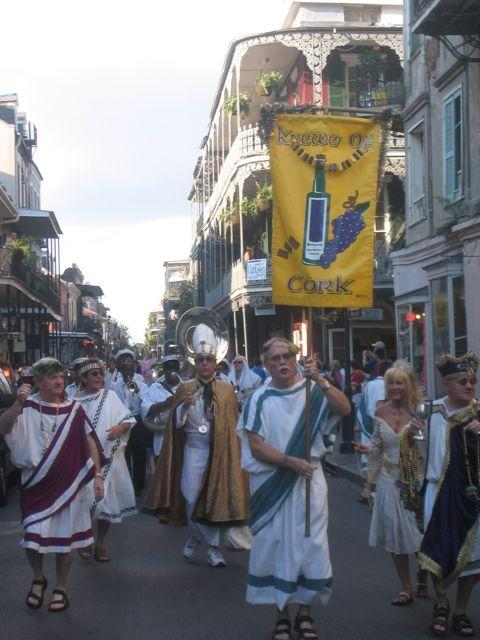 The always-festive Krewe of Cork takes to the streets during the New Orleans Wine & Food Experience.