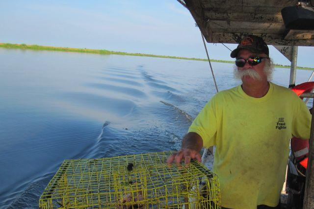 Louisiana fisherman Joey Fonseca going after crabs on the prolific inland waters around Des Allemands.