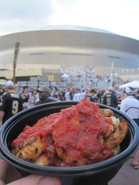 Grilled shrimp and grits with a Creole tomato sauce from Red Fish Grill starts off a game day outside the Louisiana Superdome.