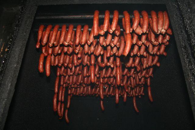 Andouille sausage cooks away in a traditional smokehouse in LaPlace.