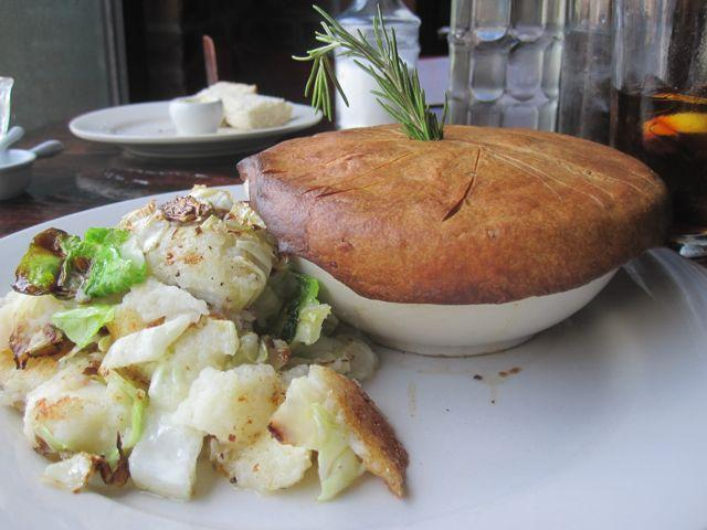 A pot pie with bubble and squeak on the side at Feast in New Orleans.